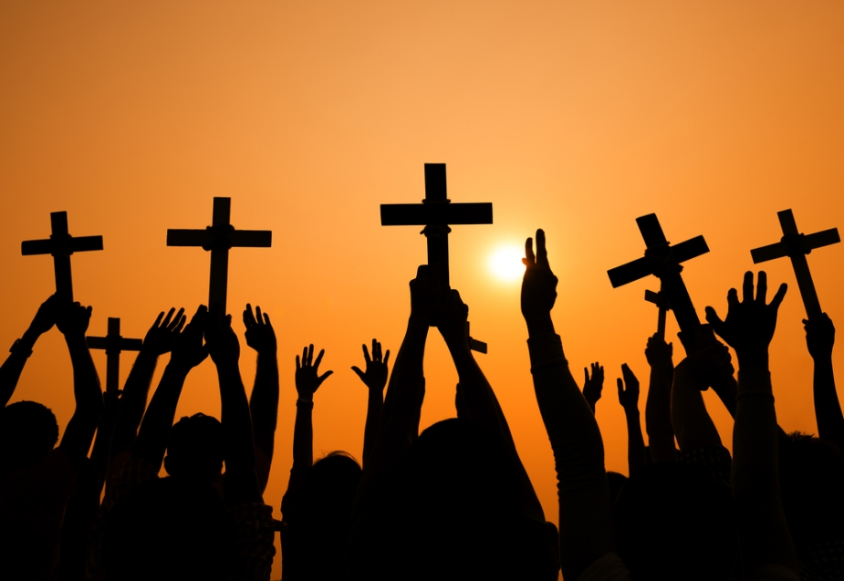 holding_crucifixes